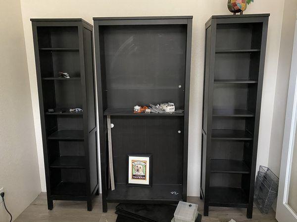 Three IKEA Hemnes bookshelves