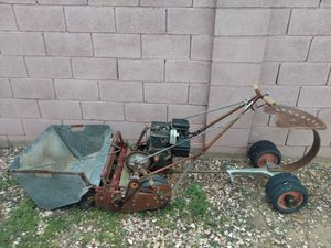 One of the first motorized lawn mowers horizontal blade self-propelled walk behind or turn it into the riding lawn mower for Sale in Phoenix, AZ