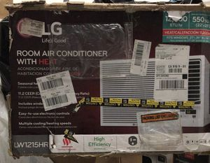 New LG 12000 btu window ac unit with heat air conditioner DENT for Sale in Houston, TX