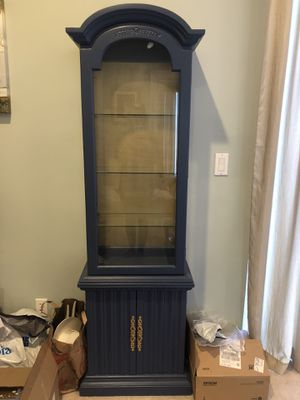 Bookcase, decorative bookshelf, Curio cabinet navy periwinkle color with gold back for Sale in Lake Worth, FL