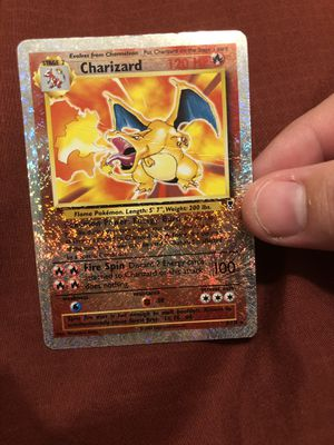 Shiny Charizard card. Rare! (There is a crease across the middle, please see pics provided) $100. The card is in a penny sleeve and top loader for Sale in Fullerton, CA