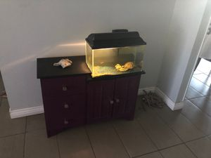 - Cabinet and tank with 3 fish and food for Sale in Tempe, AZ