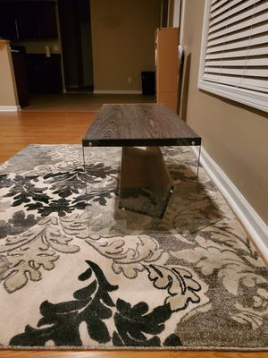 Nearly new unique coffee table. Coffee table is too small now for my new house so I have to sell it now. Glass legs/base and shelving at the bottom. for Sale in Ellenwood, GA