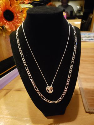 2 solid silver chains and black hills gold 12kt Angel!! 4mm 22 inch Figaro chain . Great condition!! for Sale in Meriden, CT