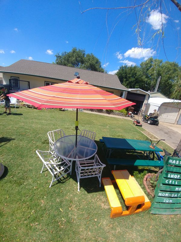 Patio set with table, 4 chairs and umbrella. $100 for all