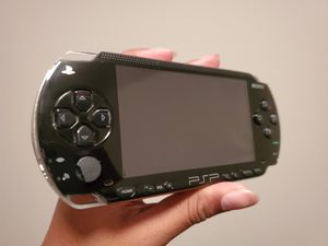 PSP 1000 (DOES NOT TURN ON) + 6 UMDs + Memory Cards for Sale in Tampa, FL