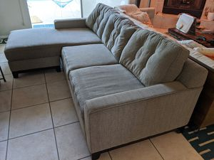Grey sectional couch - ottoman on either side for Sale in Cathedral City, CA