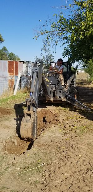 New Holland Bradco 609 back hoe minimal hours for Sale in Acampo, CA