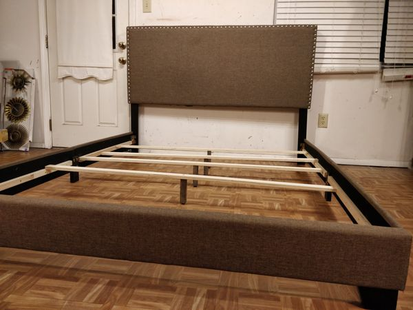 Like new Gray fabric queen bed frame with mattress in great condition, pet free smoke free.