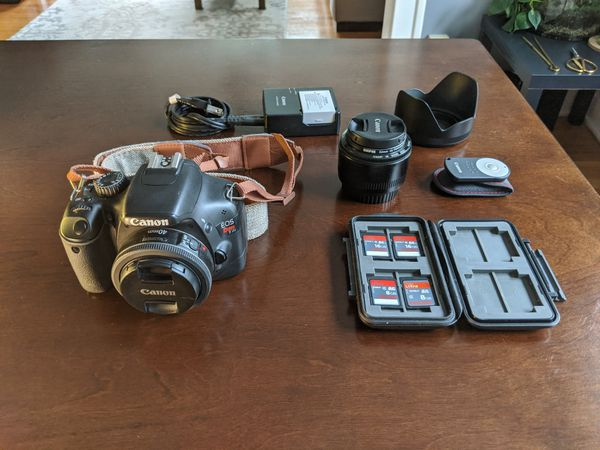 Canon Rebel T2i with 2 lenses, 4 memory cards, remote, charger, and glare hood.