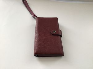 Coach Burgandi leather phone holder and wallet for Sale in San Francisco, CA