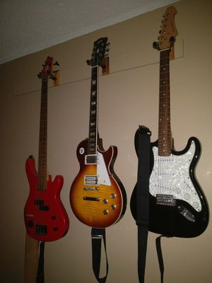 4 Guitars and 1 Bass Guitar for Sale in Fort Walton Beach, FL