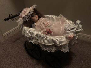 Antique ceramic doll with a musical doll carriage and a tea set for Sale in Austin, TX