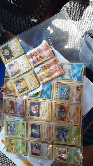 Over 40 Pokemon cards with sleeves, and7 Pikachus. for Sale in Pompano Beach, FL