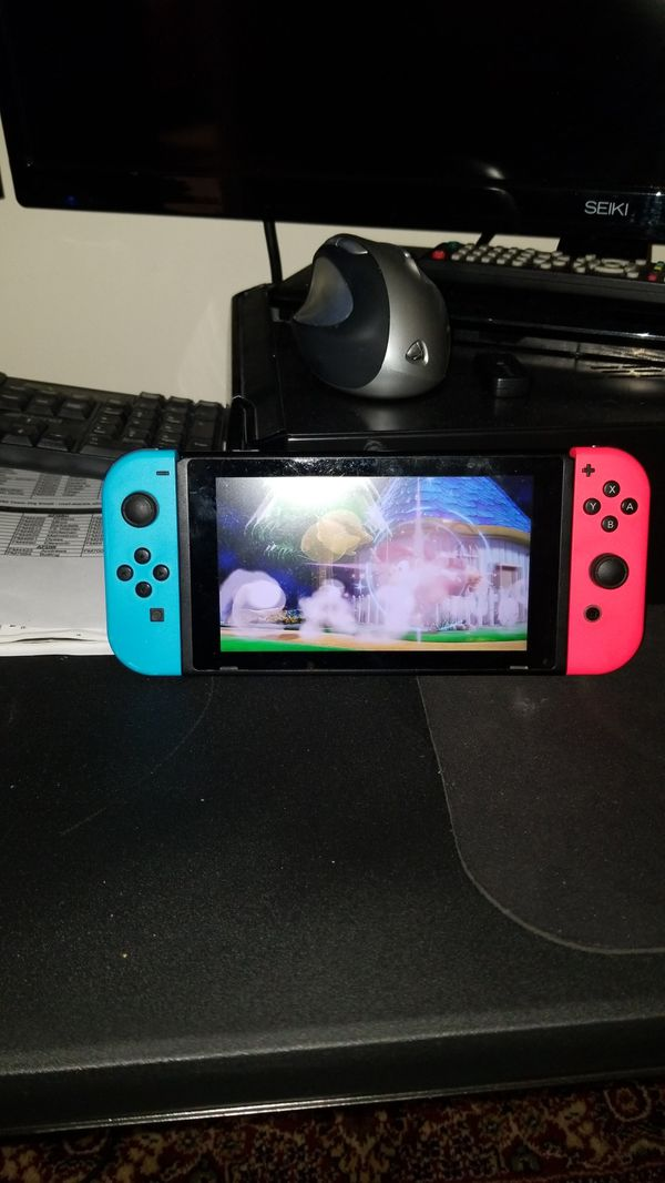 Nintendo switch comes with one power cord and Super Mario Smash Bros