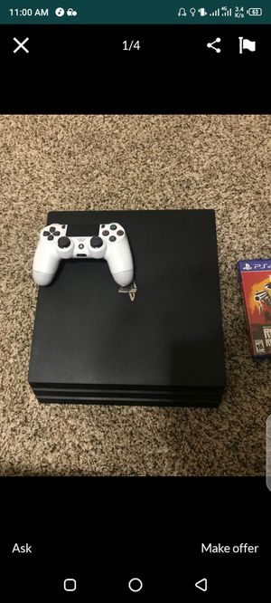 Hi there looking to sell my 1 tb PS4 pro comes with all wires and a controller and 4 games for Sale in Houston, TX