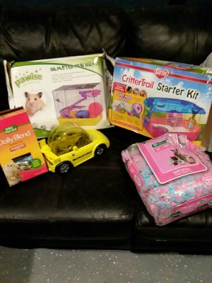 2 hamster cages ,a park , a hamster car and accessories.consisting of bedding, food and treats. for Sale in Moline, IL