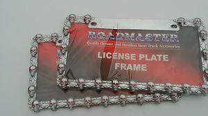 Pair of skull license plate frames for Sale in Columbus, OH