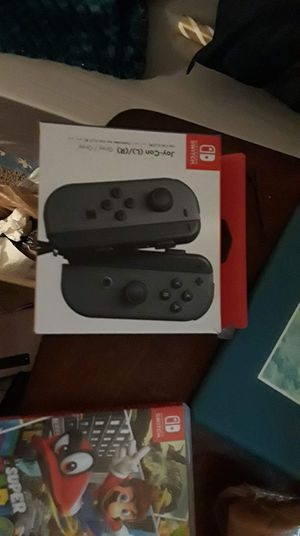 Switch lite 2 games on console 2 games on cards w joycons for Sale in East Wenatchee, WA
