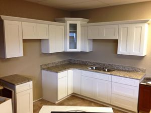 High End White All Wood Cabinets at wholesale pricing for Sale in Tampa, FL
