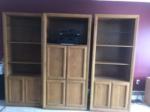 Solid Oak Bookcases plus middle section is for TV. Very well taken care of. Top shelves are glass with light for displaying. for Sale in Lohman, MO