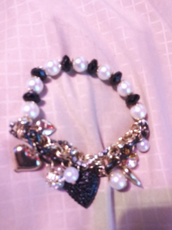 Betsey johnson black and white charm brac