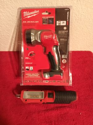 Milwaukee m18 led work light brand new and a used m12 led stick light $65 for both in good working condition for Sale in Beaumont, CA