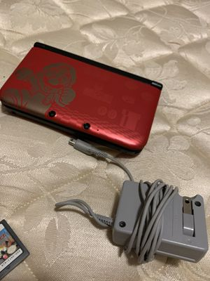 Nintendo 3DS XL( comes with charger and 2 games) for Sale in Seattle, WA