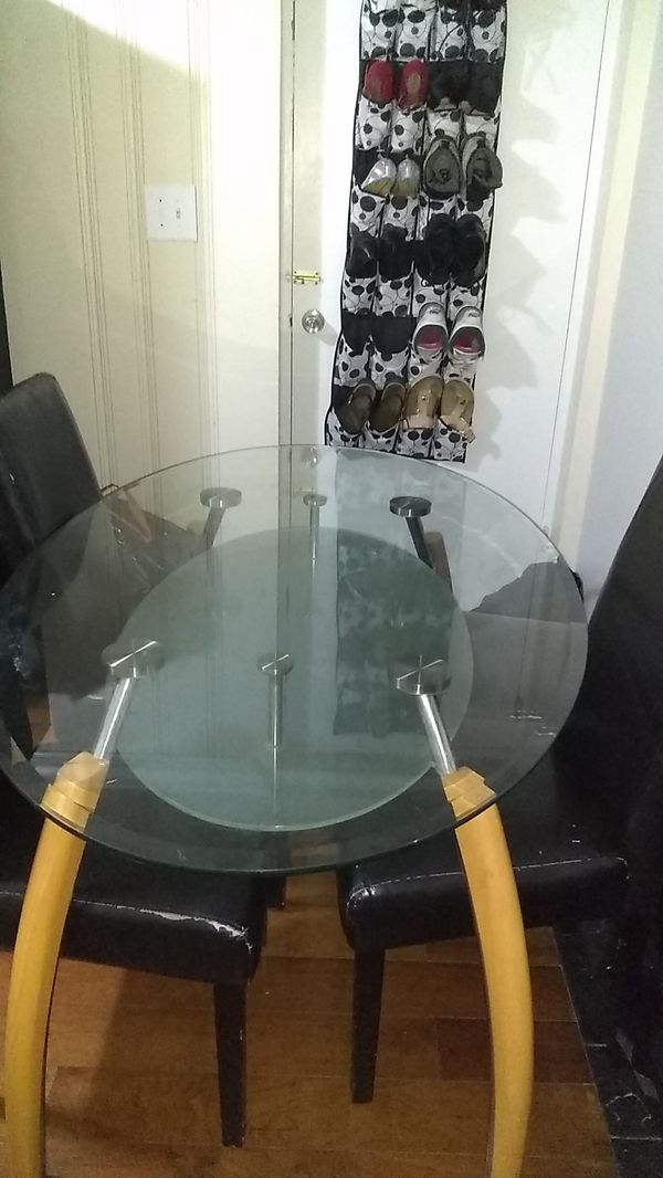 Glass table with 4 used chairs