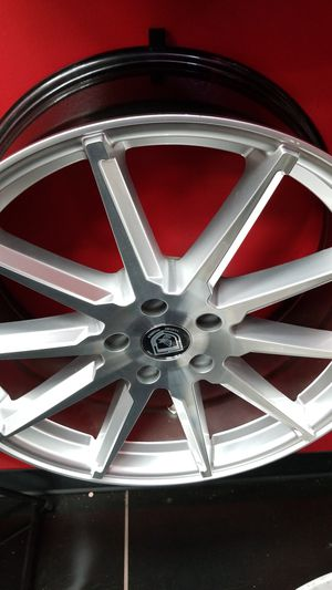 20in staggered silver rim n tires for Sale in Houston, TX