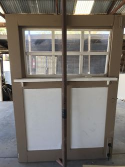 "Doors 58""x 83 1/2 I have 4 of them. Use to be on garage. Could be used for many things such as a shed or barn or garage etc. In good shape. for Sale in Glendale,  AZ"