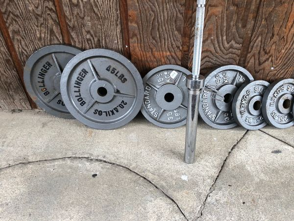 Olympic weights and 7 ft 45 lb bar with collars 45s 35s 25s 10s 5s 2.5s Barbell $60 includes collars Olympic weight set $180 Both together $220 pric