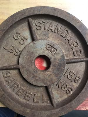 35 pound Olympic plates, bench, and doorway pull-up bar for Sale in Wichita Falls, TX