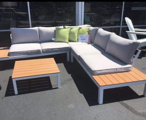 Outdoor sectional w/ table presented by modern home furniture in Everett