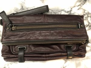 Coach designer maroon leather clutch new for Sale in Houston, TX