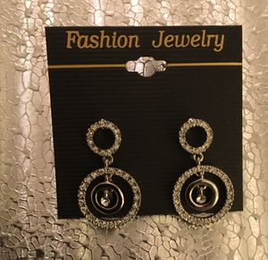 $18 OBO - DANGLE EARRINGS RHODIUM PLATED with CRYSTALS.-1.25 INCHES LONG-STUD BACKING **NEW, NEVER USED ** for Sale in Glendale, AZ