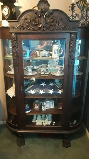 Antique Mahogany cabinet original curved glass with claw feet for Sale in Columbus, OH