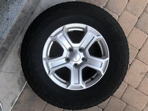 Jeep Wrangler Wheels and Tires Stock OEM 245/75/R17 for Sale in Orlando, FL