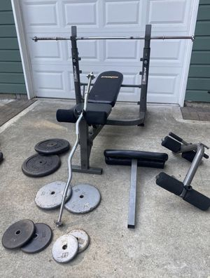 Adjustable Bench Press Rack with flat bar, ez curl bar and weights for Sale in Snohomish, WA
