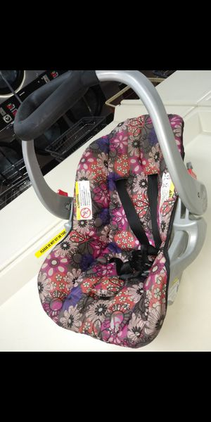 Baby infants floral print car seat pink and purple for Sale in Jacksonville, FL