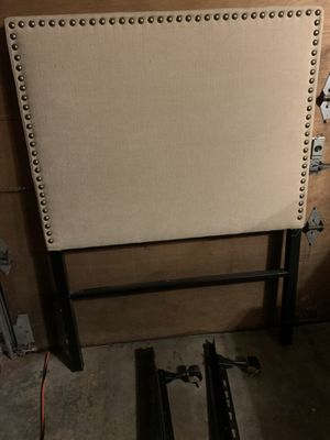 Upholstered Twin bed headboard with wheeled frame rails for Sale in Edmonds, WA