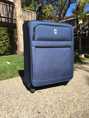 Large blue luggage suitcase with 4 wheels for Sale in MONTE VISTA, CA