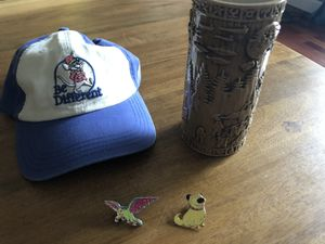 Official Disney pack: mint cantina tiki galaxy's edge tumbler, never worn junk food musketeer Be Different Hat and 2 pins. Pixar Star Wars Collectors for Sale in Seattle, WA
