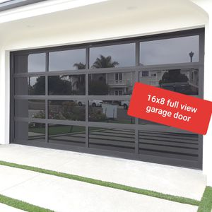 Garage Door Like New! 16x7 Full View black anodized aluminum frame with black laminate glass for Sale in Chino, CA