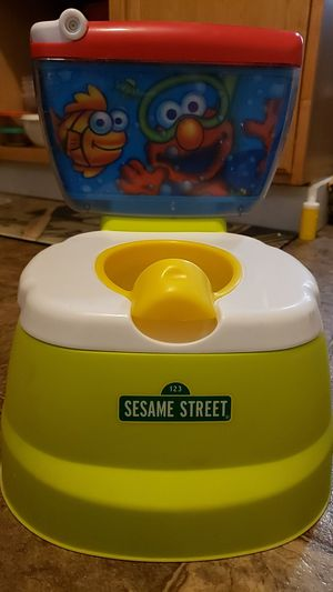 Barely used Elmo potty chair with real handle and noises.. for Sale in Fort Wayne, IN