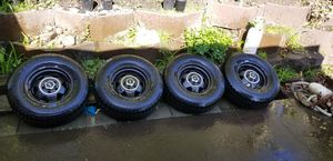 Set of 4 235/75r15 tires on jeep rims will trade for parts tools etc. for Sale in SeaTac, WA