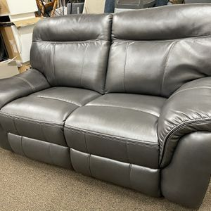 New Loveseat dark grey in a box by New Classic furniture for Sale in Durham, NC