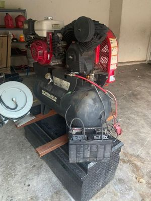 Honda air compressor and a honda motor w the holes for Sale in Houston, TX