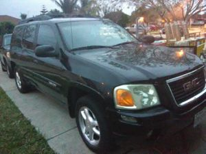 GMC ENVOY 2005 PLACAS AL CORRIENTE LEDS OUTSIDE AND INSIDE LIGHT BARS CHANGE COLORS.... A/C for Sale in Brownsville, TX