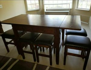 Solid wood dining table with 8 stools for Sale in Puyallup, WA